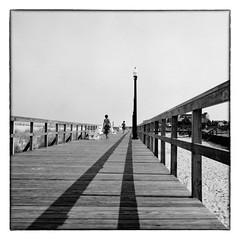 Boardwalk - Bethany Beach, DE (gastwa) Tags: ocean camera bw white black 120 6x6 film beach mediumformat landscape focus scenery fuji rangefinder bethany andrew pro fujifilm medium format 100 manual bellows fujinon folding acros foldable 80mm f35 gf670 gastwirth andrewgastwirth