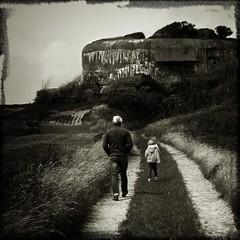 gimme shelter (_wysiwyg_) Tags: portrait blackandwhite man walking square countryside child noiretblanc bunker shelter enfant campagne homme backview carré blockhaus abri marcher