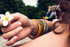 jewelry (herr_der_inge) Tags: woman flower berlin girl kreuzberg dof hand arm bokeh finger jewelry frau blume schmuck schrfentiefe tiefenschrfe 35mmf18 nikond90