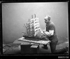 Man with a model of a fully rigged ship, 23 June 1934