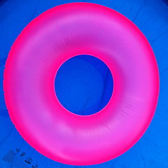 Floating pink on blue (the tomographer) Tags: pink blue summer water pool colours floating tire rubber inflatable catchy
