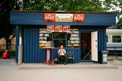 Biaystok, Poland. (Radosaw Surowiec) Tags: polska podlasie pkp trainstation fastfood 35mm analog analogue filmisnotdead canonaf35mii superia200 eating