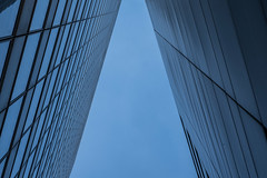 Storefront triangle (or trapezoid) (alxfink) Tags: architecture buidling facade storefront triangle trapezoid lines geometry blue bluesky cologne mediapark nrw abstract up lookingup lumix