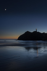 Castlepoint sunrise with Cresent Moon (dave.fergy) Tags: lighthouse building water abstract moon beach shape sunrise architecture landscape dawn on1pics cresent shapes castlepoint wellington newzealand nz