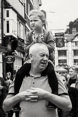 Piggy Backs (sawyersource) Tags: streetphotography street hands people father daughter piggyback child d7200 35mm nikon kingstonuponthames kingston carnival candid unsuspecting carry