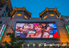 Beijing, China - A large screen in the main shopping square on Wangfujing Street in Beijing. (Remsberg Photos) Tags: asia china beijing city streetfood world travel sightseeing locals tourists crowded buy sell commerce culture outdoors tradition wangfujing street shopping shops clothing streetsigns chn