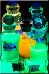 Poisons and Potions (Boba Fett3) Tags: bottle closeup upclose uv blacklight glow green glass