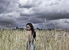the storm's companion (meg.reilly) Tags: portrait selfportrait storm nature girl field rain clouds self dark skinny outside outdoors 50mm shadows dress d70 wind nikond70 wheat exploring grain anger explore polkadots portraiture thunderstorm lightning brunette stormbrewing thunder wheatfield nikkor50mm lowaperture