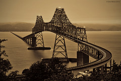 Steel Crest (Dan Mihai) Tags: morning bridge water monochrome fog sepia clouds oregon sunrise dawn washington steel crest columbiariver astoria pacificnorthwest megler astoriabridge trussbridge pointellice