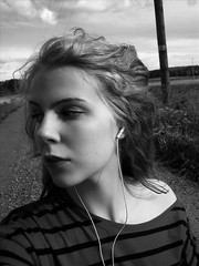 A storm is rising (prettylittlelife7) Tags: road bw storm nature girl ahead shirt hair wind stripe stare bwgirlnatureblondeblondportraitemotionsimple