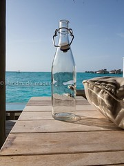 Empty Bottle (Mohmed Althani) Tags: travel sea summer cold color beach water photo day drink bluewater reef maldives