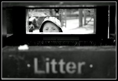 Put your litter in the bin. (PaulEBennett) Tags: boy white black mono child bin litter bolton mossbank