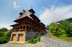 The Orthodox Barsana Monastery,Maramures,Romania (Dragos Cosmin- Getty Images Artist) Tags: life wood travel flowers blue light red summer vacation sky orange cloud white plant color building green tower art tourism church monument beautiful grass saint architecture clouds concentration wooden site alley scenery europe solitude day peace natural artistic time outdoor path walk faith religion pray cement scenic landmark s courtyard visit christian clean clear monastery romania vegetation meditation inspirational simple inspire orthodox transilvania barsana attraction pictorial touristic maramures birsana