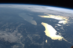 Great Lakes in Sunglint (NASA, International Space Station, 06/14/12) (NASA's Marshall Space Flight Center) Tags: ohio newyork ontario canada niagarafalls illinois novascotia lakeerie pennsylvania earth michigan greatlakes nasa aurora lakeontario fingerlakes limb lakehuron noctilucentclouds su