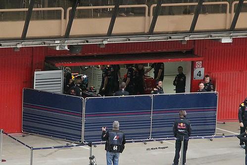 Sebastian Vettel gets into his Red Bull at Formula One Winter Testing, Circuit de Catalunya, March 2012
