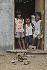 Two Smiles (Ryan Sedgwick) Tags: city windows people baby beach colors buildings children landscape asia doors cityscape sony philippines streetphotography views alpha