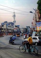 Madurai Street Scene (bodythongs) Tags: street india men bike bicycle canon temple minaret indian august scene mosque ixus madurai tamil minar templo tamilnadu tempel southindia nadu           bodythongs          tempio
