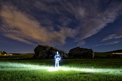 Big Rock night patrol (John Andersen (JPAndersen images)) Tags: alberta aurora bigrock clouds glacialerratic lightpainting night self sky stars