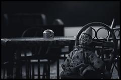 Party of One (Joe Corll) Tags: vintage abandoned creepy creep old house pa meadville baldwin museum clown toy toys table teapot macro close dov depth field wooden chair monochrome blue cyan cyanotype otype type hue monochromatic blackandwhite black white bandw bw alnoe alone corll nikon d3300 1855 18 55 kit lens kitlens