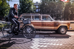 Talk + ride (farflungistan) Tags: asundaycarpic amsterdam car holland jordaan nederland netherlands prinsengracht streetphotography bikes