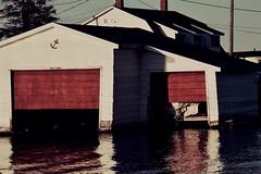 Boathouse (mclainjokinen) Tags: adventure lake kayak boathouse boat uppermichigan up water reflections nikon michigan