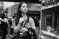 Sony Shooter (Cliff.j) Tags: sony girl brick lane candid eye contact market street unposed look camera stranger gesture bag hand mirrorless outdoor shoreditch london bokeh portrait food