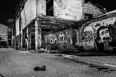 Ne pas tre dans ses baskets (vedebe) Tags: usine usinedsaffecte ville rue city street urbain urbex noiretblanc netb nb bw monochrome architecture