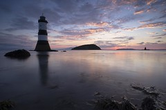 Sunrise at Penmon (sion_rhys) Tags: penmon canon landscape wales anglesey lighthouse water sunrise seascape seaweed clouds dark reflections