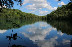 ROUND LAKE REFLECTION (outdoorpict) Tags: clouds sky white fluffy blue smooth reflection trees green forest water fall park landmark