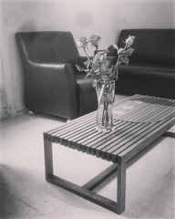 Salle d'attente (Am!natoS) Tags: instagramapp square squareformat iphoneography uploaded:by=instagram willow blackandwhite blackwhite black white roses bouquet vase fleurs flowers sofa table aminatos mobileography stilllife still life