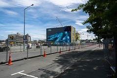 To Come Down (Jocey K) Tags: newzealand christchurch archtiecture buildings street road roadcones mural streetart art painting crane cbd clouds sky rebuild shadows trees