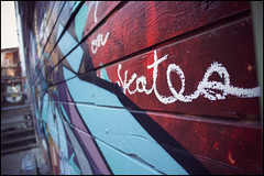 """""""On skates"""" (Eric Flexyourhead (Moving mode!)) Tags: old city blue red urban canada detail building art wall vancouver graffiti bc britishcolumbia decay vibrant burgundy vivid wear worn weathered colourful strathcona fragment olympusep1 panasoniclumixg14mmf25"""