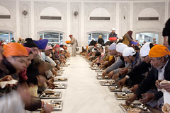 Dining Hall at the Delhi Sikh Temple  _4140 (hkoons) Tags: boy food man male men hat dinner temple worship feeding god eating masculine taxi prayer religion turban sikh headgear gurudwarabanglasahib