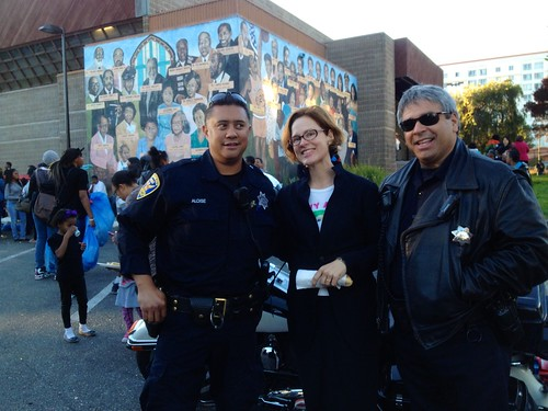 Thea Selby poses with Northern Station Police at Ella Hill Hutch Community Center