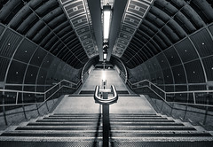Transit (vulture labs) Tags: city uk travel light england urban bw white black building london art station architecture modern stairs londonbridge underground subway photography photo nikon europe angle metro interior capital wide perspective railway tunnel staircase transit 1000 cityoflondon d700 1424mm vulturelabs