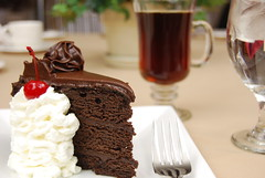 Chocolate cake and coffee (RandyBess) Tags: red food brown white water coffee cake fruit cherry table dessert restaurant eating chocolate rich plate sugar slice bakery snack fancy sweets treat piece serving indulgence frosting baked frosted
