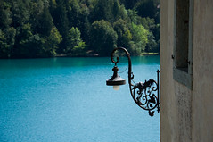 the lamp and the lake (marin.tomic) Tags: wood travel blue alps detail nature lamp wall forest island see nikon europe natural slovenia alpine bled slovenija slowenien otok lakebled jezero d90 bledisland