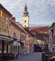 before first coffee (cherryspicks (intermittently on/off)) Tags: architecture building street zagreb croatia tkalciceva morning church house travel verticalpanorama historic stmaryschurch spire sunlight