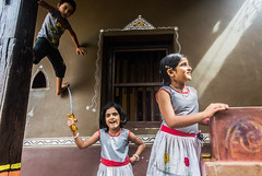 Play time | Streets of Gokarna,India (vjisin) Tags: india asia karnataka cwc cwc534 chennaiweekendclickers nikond3200 nikonofficial nikonindia nikon composition outdoor street streetphotography gokarna abstract texture indianman culture hindu life home house colours child girls kids kid window heritage children playing