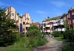 Housing complex in Plochingen by F. Hundertwasser (Sokleine) Tags: hundertwasser house building complex housing architecture courtyard plochingen badenwrttemberg germany deutschland allemagne windows fentres balcons balconies colours fancy