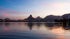 Sunset | Lagoa Rodrigo de Freitas (Jos Eduardo Nucci) Tags: southamerica sunset riodejaneiro olympiccity lagoarodrigodefreitas nikon d800 28300mm lagoon landscape twilight bluehour sky colors relax discover long exposure outdoor picture beautiful world photography day friday olympic jos nucci brazilian people tour travel pink yellow tide nature paradise mountains reflection water mirror shadow dark lights white rio2016 sight evening night sunny clouds tropical sunshine leblon beach ipanema joseduardonucci getty explore experience