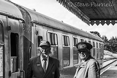 The Stationmaster And the Guard Mono (Steve Purnell Photography) Tags: stationmaster guard station travel train transport rail conductor railroad tourism transportation symbol trip employee hat background jacket people tie uniform professional happy safety holiday mustache isolated service old thumb tour person