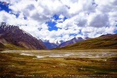 Landscape of Khunjrab (AQAS) Tags: hunza gilgit kkh mountains clouds light landscape ancient history nature colors hill river mountainside grassland indus khunjrab pass pakchina