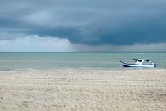 Storm At Sea (Anna Hari) Tags: 2016 fujifilm xm1 malaysia beach sea water penang sand boat sky skyscape storm rain clouds grey parasailing landscape seascape shore seaside outdoor