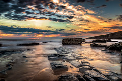 Golden glow at Southerndown (karlmccarthy1969) Tags: sunset ocean seascape rocks glow golden sea sand sky clouds wales uk southerndown