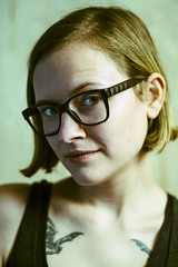 Brittany (buckadilla) Tags: experimental color contrast plywood model babe woman glasses blonde bob bats tattooos