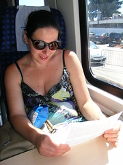 1st class Train Travel in Croatia (seanfderry-studenna) Tags: nina first class train travel croatia croatian hrvatska serb seat sitting seated window table carriage paper sunglasses summer august 2016 vacation holiday dress blue handbag crisps straps hands arms shoulders skin bare tan atnned neck throat ear face pink lips mouth brunette dark hair sun sunshine beauty beautiful stunngin gorgeous cute charm charming europe european woman female girl lady girlfriend fiancee wife happy smile smiling people person indoor candid public transport shade shadow