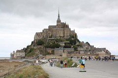 Le Mont Saint-Michel on the border between Normandy and Brittany with a monastry and village within its protective walls. (Shandchem) Tags: france history rock architecture wonder religious island brittany san tumba monks granite michel benedictine normandy mont tidal islet 708 hermits igneous lemontsaintmichel aubert 6thcentury saintmichael 9thcentury mountsaintmichel tombelaine granulite monttombe clayeycalceroussand revelatioecclesiaesanctimichaelis bishopodavranches