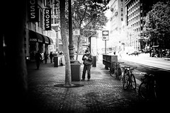 Bin Talking (stephen cosh (on holiday)) Tags: life sanfrancisco california street leica city people blackandwhite bw sepia dumpster mono town candid streetphotography rangefinder bin bayarea siliconvalley reallife humancondition blackandwhitephotos 50mmsummilux blackwhitephotos