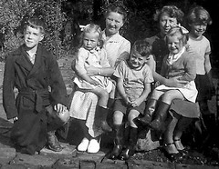Harrogate NCH Summer Photograph (theirhistory) Tags: boy girl shirt garden outdoors belt shoes dress sister sandals bow jumper raincoat wellies nch ncho nationalchildrenshome